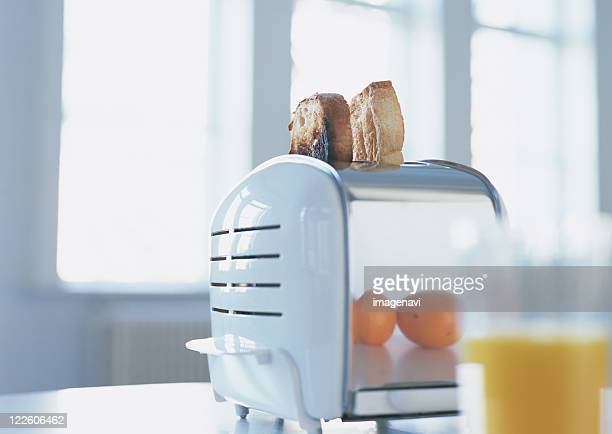 Toasts and toaster, orane juice