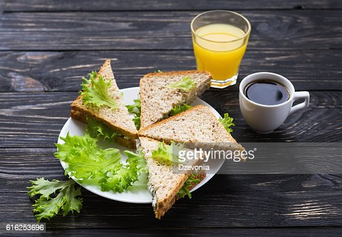 Toasts, cup of coffee and orange juice : Foto de stock