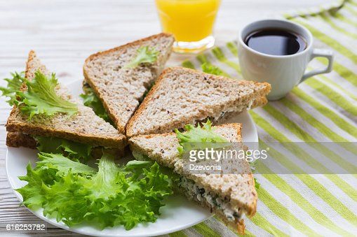 Toasts, cup of coffee and orange juice : Stock Photo