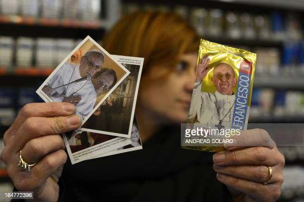 A tobacco and newspapers seller shows the new stickers dedicated to Pope Francis to collect in an album of 400 images on sale on March 28 2013 in...
