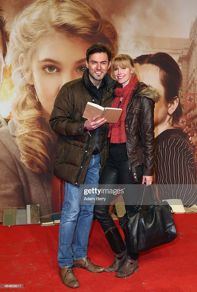 Tobey Wilson (L) and Sabrina Gehrmann arrive for the German premiere of the film 'The Book Thief' (Die Buecherdiebin) at Zoo Palast on January 23, 2014 in Berlin, Germany.