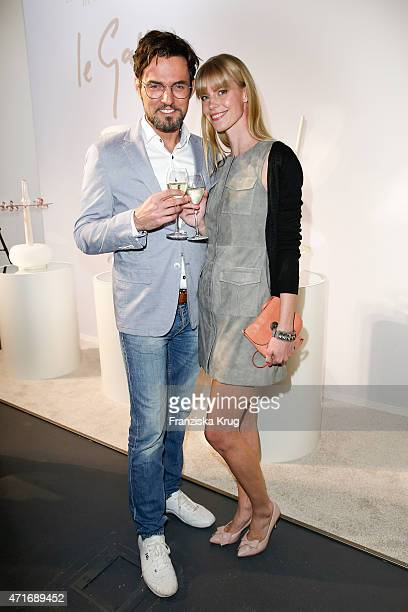 Tobey Wilson and Sabrina Gehrmann attend the Hubert le Gall Vernissage At Ruinart PopUp Gallery on April 30 2015 in Berlin Germany