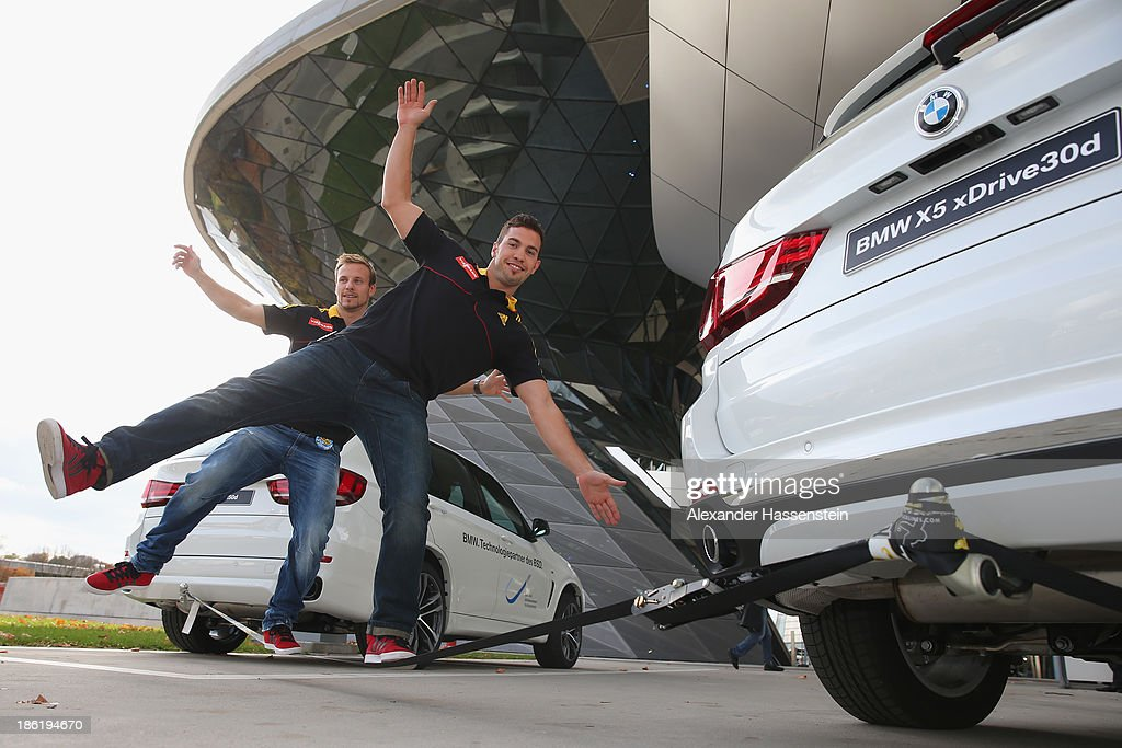 Tobias Arlt (L) and Tobias Wendl slacklining after the season opening press conference of the German Bobsleigh and Skeleton federation at BMW Welt on October 29, 2013 in Munich, Germany.