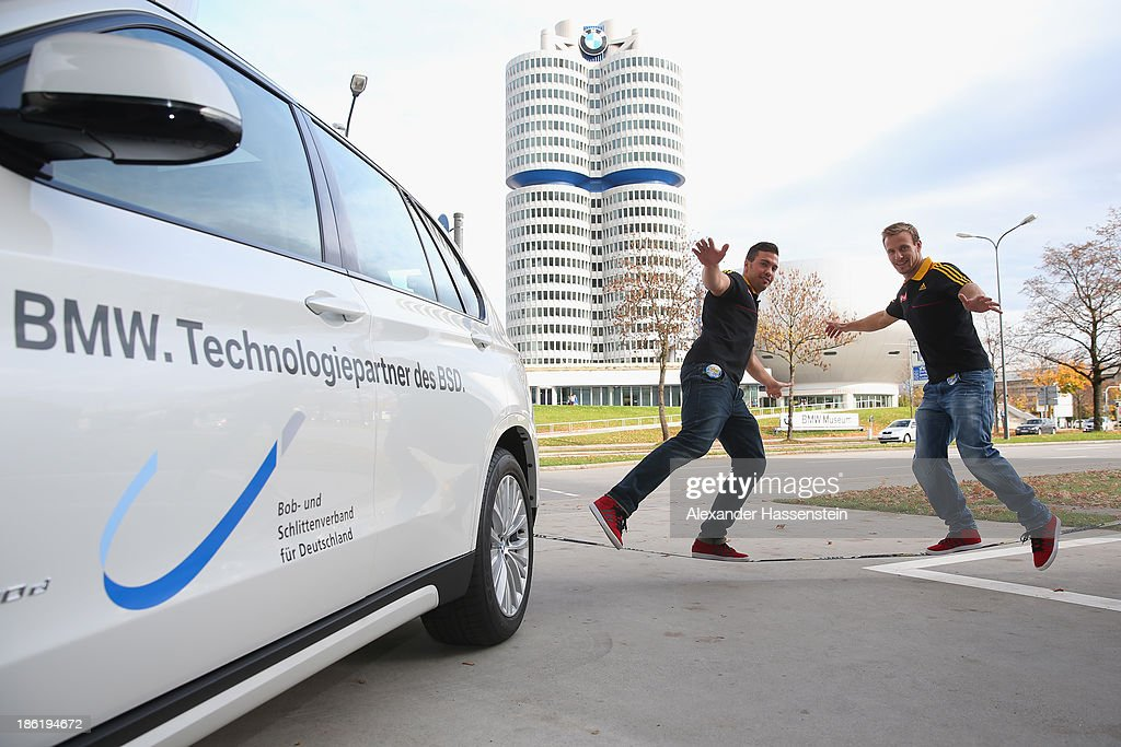Tobias Arlt (R) and Tobias Wendl slacklining after the season opening press conference of the German Bobsleigh and Skeleton federation at BMW Welt on October 29, 2013 in Munich, Germany.