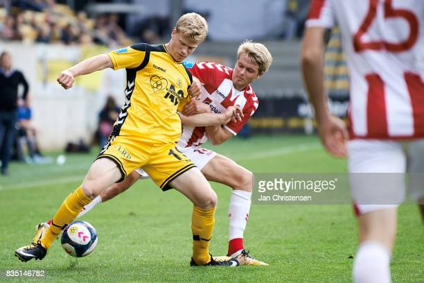 Tobias Arndal of AC Horsens and Magnus Christensen of AaB Aalborg compete for the ball during the Danish Alka Superliga match between AC Horsens and...
