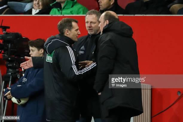 Tobias Christ speak with Thomas Linke of Ingolstadt and CEO Jörg Schmadtke of Cologne during the Bundesliga match between FC Ingolstadt 04 and 1 FC...