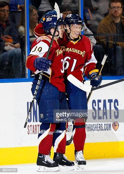 Tobias Enstrom celebrates his goal with Maxim Afinogenov of the Atlanta Thrashers during the game against the Boston Bruins at Philips Arena on...
