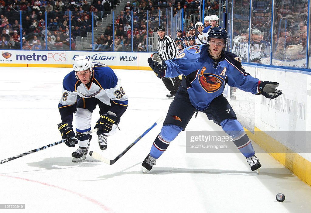<a gi-track='captionPersonalityLinkClicked' href=/galleries/search?phrase=Tobias+Enstrom&family=editorial&specificpeople=2538468 ng-click='$event.stopPropagation()'>Tobias Enstrom</a> #39 of the Atlanta Thrashers reacts after being slashed by B. J. Crombeen #26 of the St. Louis Blues at Philips Arena on December 21, 2010 in Atlanta, Georgia.