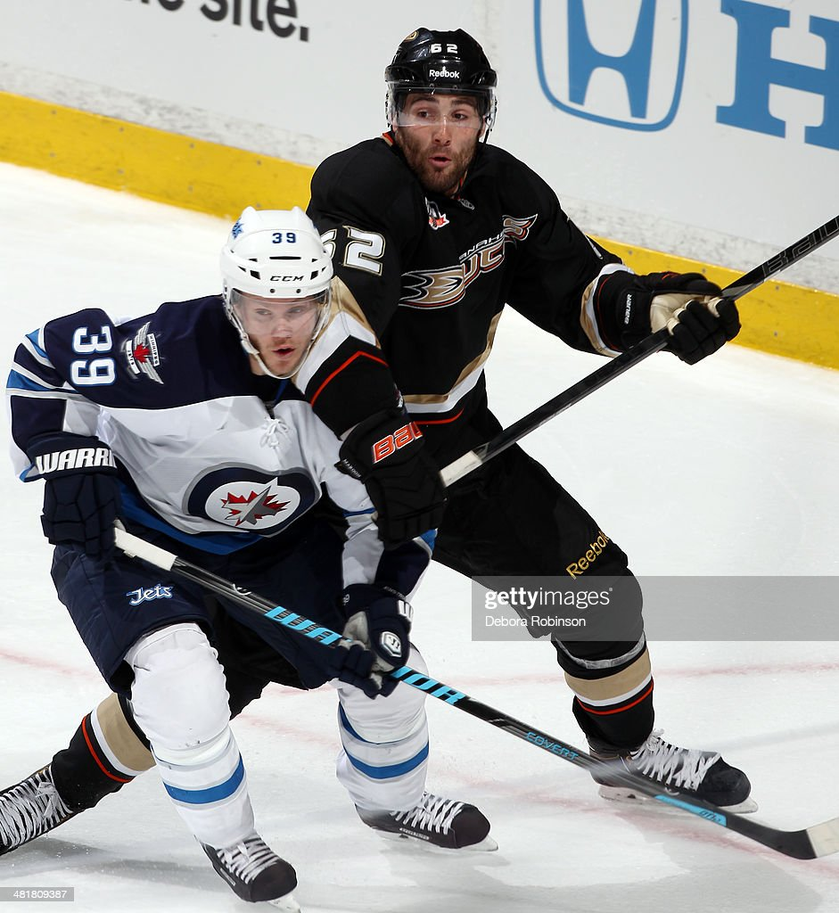 <a gi-track='captionPersonalityLinkClicked' href=/galleries/search?phrase=Tobias+Enstrom&family=editorial&specificpeople=2538468 ng-click='$event.stopPropagation()'>Tobias Enstrom</a> #39 of the Winnipeg Jets battles for position against <a gi-track='captionPersonalityLinkClicked' href=/galleries/search?phrase=Mathieu+Perreault&family=editorial&specificpeople=776813 ng-click='$event.stopPropagation()'>Mathieu Perreault</a> #22 of the Anaheim Ducks on March 31, 2014 at Honda Center in Anaheim, California.