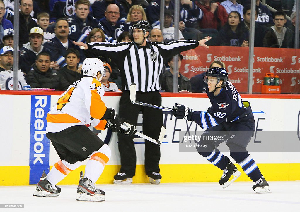 <a gi-track='captionPersonalityLinkClicked' href=/galleries/search?phrase=Tobias+Enstrom&family=editorial&specificpeople=2538468 ng-click='$event.stopPropagation()'>Tobias Enstrom</a> #39 of the Winnipeg Jets follows the play down the ice as <a gi-track='captionPersonalityLinkClicked' href=/galleries/search?phrase=Kimmo+Timonen&family=editorial&specificpeople=201521 ng-click='$event.stopPropagation()'>Kimmo Timonen</a> #44 of the Philadelphia Flyers defends during second period action at the MTS Centre on February 12, 2013 in Winnipeg, Manitoba, Canada.