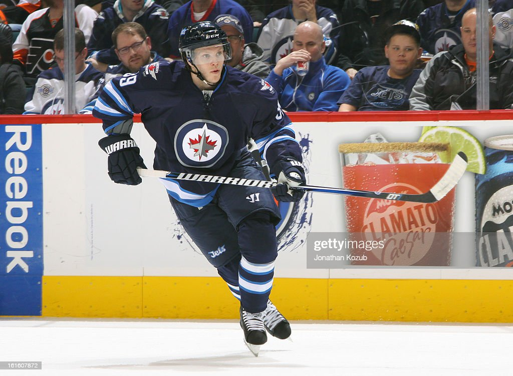 <a gi-track='captionPersonalityLinkClicked' href=/galleries/search?phrase=Tobias+Enstrom&family=editorial&specificpeople=2538468 ng-click='$event.stopPropagation()'>Tobias Enstrom</a> #39 of the Winnipeg Jets follows the play up the ice during third period action against the Philadelphia Flyers at the MTS Centre on February 12, 2013 in Winnipeg, Manitoba, Canada.