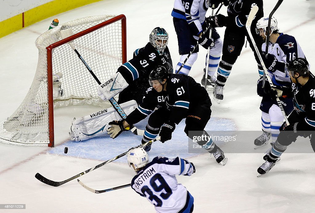 <a gi-track='captionPersonalityLinkClicked' href=/galleries/search?phrase=Tobias+Enstrom&family=editorial&specificpeople=2538468 ng-click='$event.stopPropagation()'>Tobias Enstrom</a> #39 of the Winnipeg Jets scores the game-winning goal with a shot that got past Justin Braun #61 and goalie <a gi-track='captionPersonalityLinkClicked' href=/galleries/search?phrase=Antti+Niemi&family=editorial&specificpeople=213913 ng-click='$event.stopPropagation()'>Antti Niemi</a> #31 of the San Jose Sharks at SAP Center on March 27, 2014 in San Jose, California.