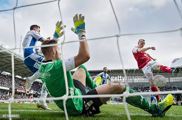 Tobias Eriksson of Kalmar FF shoots in the opening 01 goal behind John Alvbage goalkeeper of IFK Goteborg and Jakob Ankersen of IFK Goteborg during...