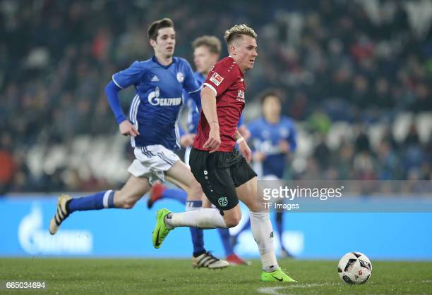 Tobias Fleckstein of Schalke and Felix Klaus of Hannover battle for the ball during the friendly match between Hannover 96 an FC Schalke 04 at...
