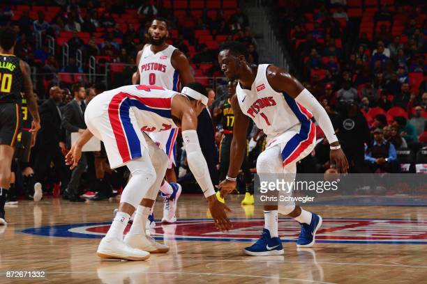 Tobias Harris and Reggie Jackson of the Detroit Pistons high five during the game against the Atlanta Hawks on November 10 2017 at Little Caesars...