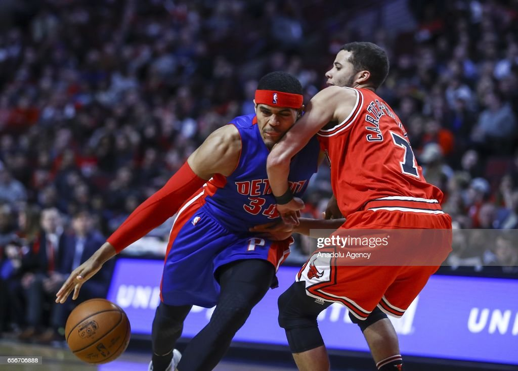 Tobias Harris (34) of Detroit Pistons in action against Michael Carter-Williams (R) of Chicago Bulls during the NBA match between Chicago Bulls vs Detroit Pistons at the United Center in Chicago, Illinois, United States on March 22, 2017.