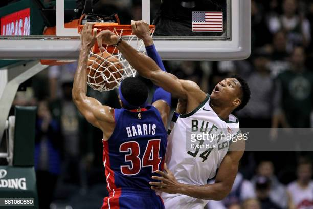 Tobias Harris of the Detroit Pistons dunks the ball over Giannis Antetokounmpo of the Milwaukee Bucks in the second quarter during a preseason game...