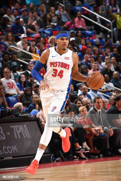 Tobias Harris of the Detroit Pistons handles the ball against the Charlotte Hornets on October 18 2017 at Little Caesars Arena in Detroit Michigan...