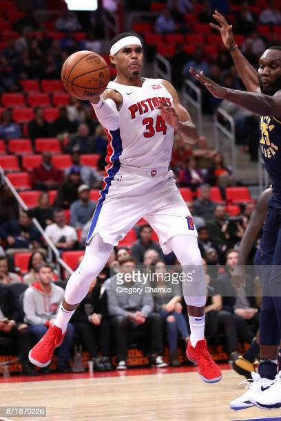 Tobias Harris of the Detroit Pistons passes against Al Jefferson of the Indiana Pacers during the second half at Little Caesars Arena on November 9...