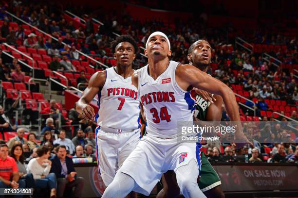 Tobias Harris of the Detroit Pistons Stanley Johnson of the Detroit Pistons and Khris Middleton of the Milwaukee Bucks awaot the ball during the game...