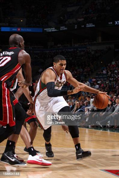 Tobias Harris of the Milwaukee Bucks drives to the basket against Joel Anthony of the Miami Heat during the game on December 29 2012 at the BMO...