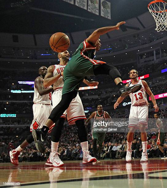 Tobias Harris of the Milwaukee Bucks looses control of the ball after being fouled by Carlos Boozer of the Chicago Bulls at the United Center on...