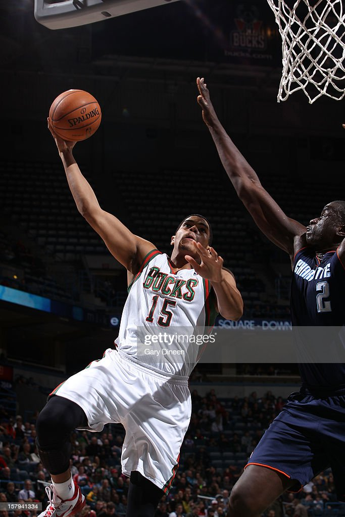 Tobias Harris #15 of the Milwaukee Bucks shoots against DeSagana Diop #2 of the Charlotte Bobcats during the game on December 7, 2012 at the BMO Harris Bradley Center in Milwaukee, Wisconsin.