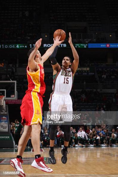 Tobias Harris of the Milwaukee Bucks shoots against Donatas Motiejunas of the Houston Rockets on January 4 2013 at the BMO Harris Bradley Center in...