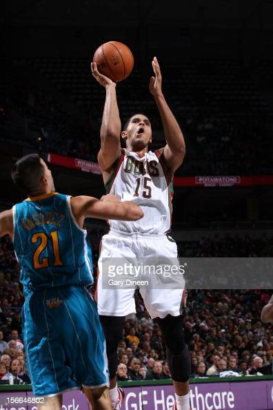 Tobias Harris of the Milwaukee Bucks shoots against Greivis Vasquez of the New Orleans Hornets during the NBA game on November 17 2012 at the BMO...