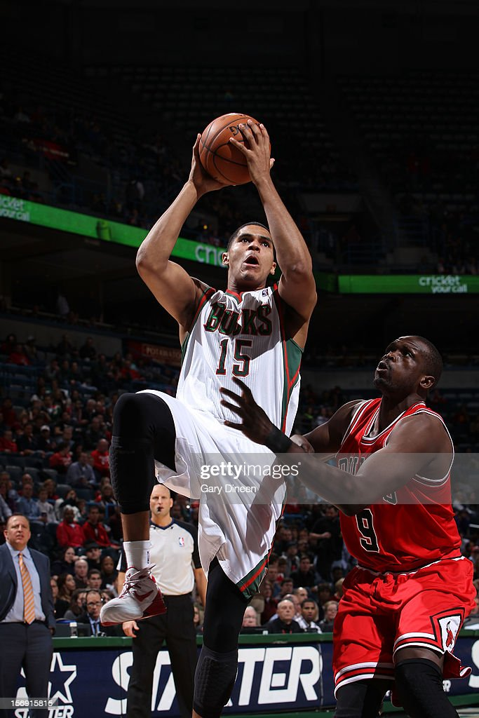 Tobias Harris #15 of the Milwaukee Bucks shoots against Luol Deng #9 of the Chicago Bulls during the NBA game on November 24, 2012 at the BMO Harris Bradley Center in Milwaukee, Wisconsin.