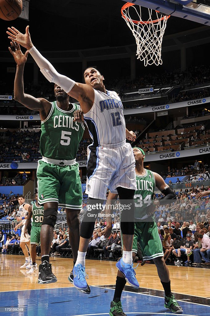 <a gi-track='captionPersonalityLinkClicked' href=/galleries/search?phrase=Tobias+Harris&family=editorial&specificpeople=6902922 ng-click='$event.stopPropagation()'>Tobias Harris</a> #12 of the Orlando Magic and <a gi-track='captionPersonalityLinkClicked' href=/galleries/search?phrase=Kevin+Garnett&family=editorial&specificpeople=201473 ng-click='$event.stopPropagation()'>Kevin Garnett</a> #5 of the Boston Celtics battle for the ball control during the game between the Boston Celtics and the Orlando Magic on April 13, 2013 at Amway Center in Orlando, Florida.