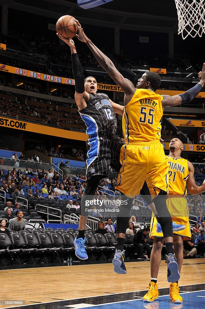 Tobias Harris #12 of the Orlando Magic attempts a shot against Roy Hibbert #55 of the Indiana Pacers on March 8, 2013 at Amway Center in Orlando, Florida.