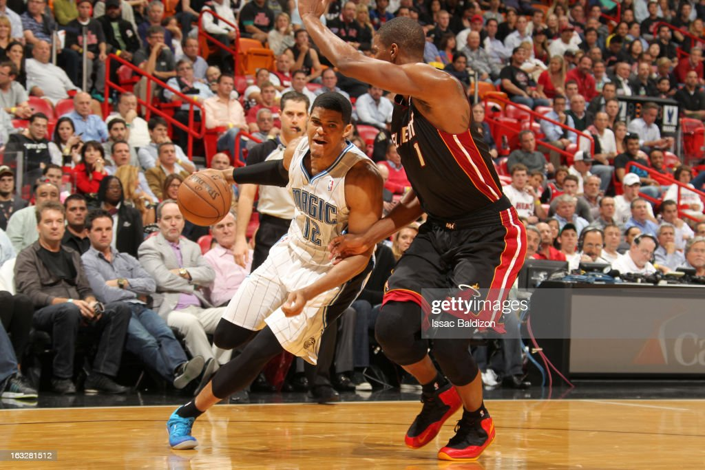 Tobias Harris #12 of the Orlando Magic drives against Chris Bosh #1 of the Miami Heat during the game between the Orlando Magic and the Miami Heat on March 6, 2013 at American Airlines Arena in Miami, Florida.