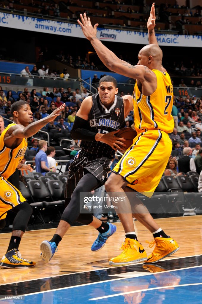 Tobias Harris #12 of the Orlando Magic drives to the basket against David West #21 of the Indiana Pacers on March 8, 2013 at Amway Center in Orlando, Florida.