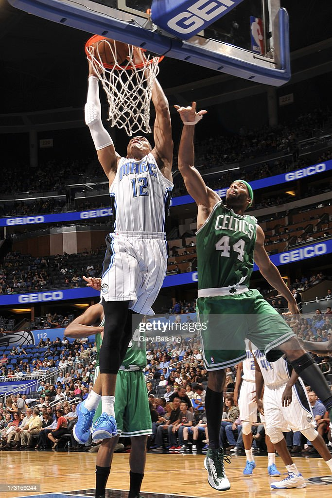 <a gi-track='captionPersonalityLinkClicked' href=/galleries/search?phrase=Tobias+Harris&family=editorial&specificpeople=6902922 ng-click='$event.stopPropagation()'>Tobias Harris</a> #12 of the Orlando Magic goes to the basket against <a gi-track='captionPersonalityLinkClicked' href=/galleries/search?phrase=Chris+Wilcox&family=editorial&specificpeople=202038 ng-click='$event.stopPropagation()'>Chris Wilcox</a> #44 of the Boston Celtics during the game between the Boston Celtics and the Orlando Magic on April 13, 2013 at Amway Center in Orlando, Florida.