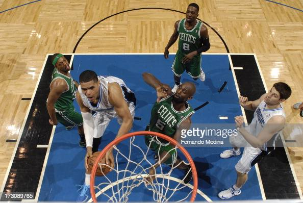 Tobias Harris of the Orlando Magic goes to the basket against Paul Pierce and Kevin Garnett of the Boston Celtics on April 13 2013 at Amway Center in...