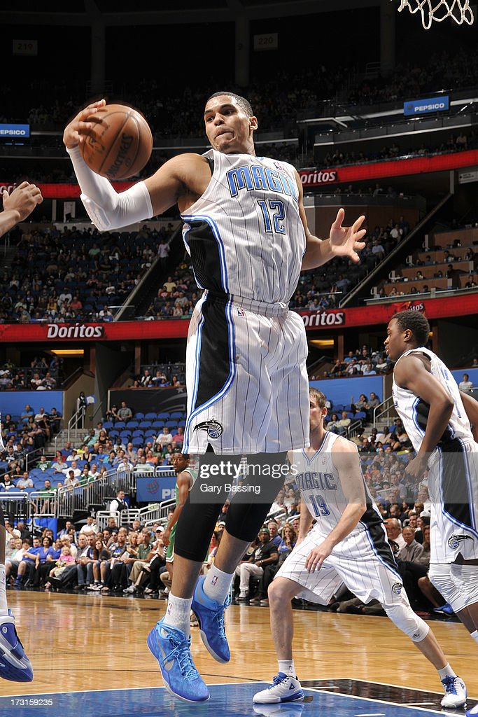 <a gi-track='captionPersonalityLinkClicked' href=/galleries/search?phrase=Tobias+Harris&family=editorial&specificpeople=6902922 ng-click='$event.stopPropagation()'>Tobias Harris</a> #12 of the Orlando Magic grabs a rebound during the game between the Boston Celtics and the Orlando Magic on April 13, 2013 at Amway Center in Orlando, Florida.