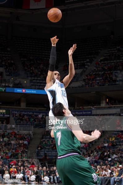 Tobias Harris of the Orlando Magic shoots against Ersan Ilyasova of the Milwaukee Bucks on March 17 2013 at the BMO Harris Bradley Center in...
