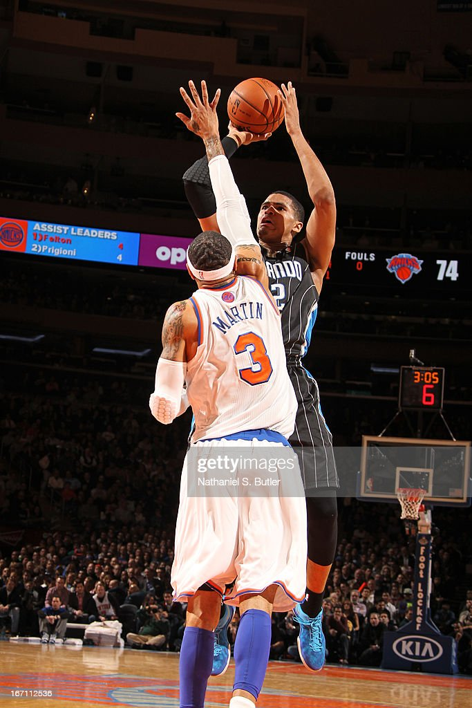 Tobias Harris #12 of the Orlando Magic shoots against Kenyon Martin #3 of the New York Knicks on March 20, 2013 at Madison Square Garden in New York City.