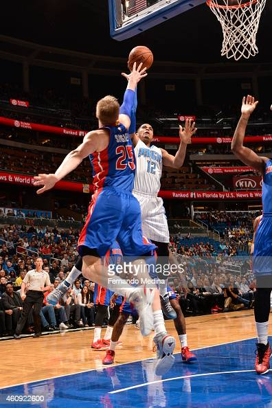 Tobias Harris of the Orlando Magic shoots against Kyle Singler of the Detroit Pistons on December 30 2014 at Amway Center in Orlando Florida NOTE TO...