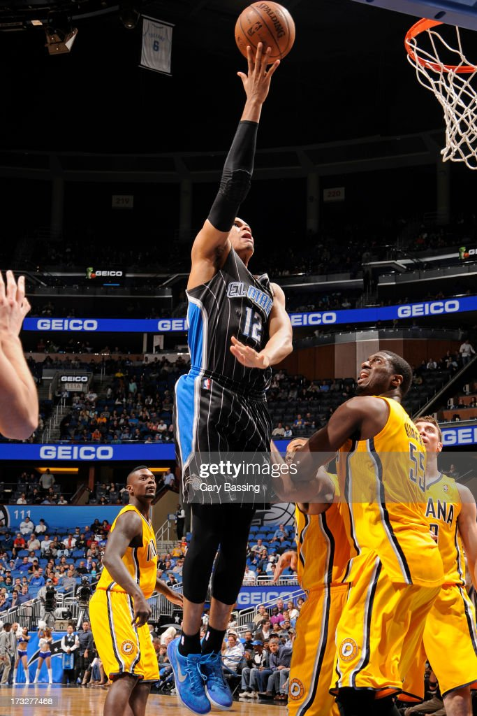 Tobias Harris #12 of the Orlando Magic shoots over Roy Hibbert #55 of the Indiana Pacers of during a game on March 8, 2013 at Amway Center in Orlando, Florida.