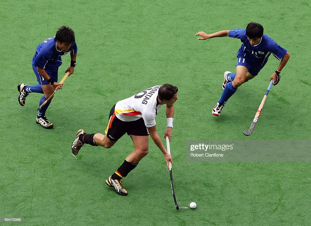 Tobias Hauke of Germany is pressured during the match between Korea and Germany on day two of the 2009 Hockey Champions Trophy at the State Netball...
