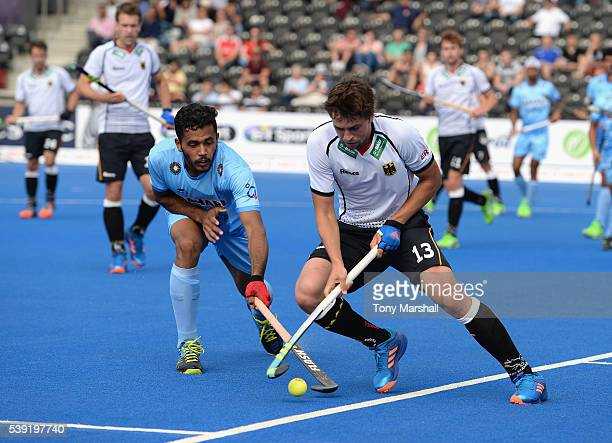 Tobias Hauke of Germany is tackled by Harmanpreet Singh of India during the FIH Men's Hero Hockey Champions Trophy 2016 Day One match between Germany...