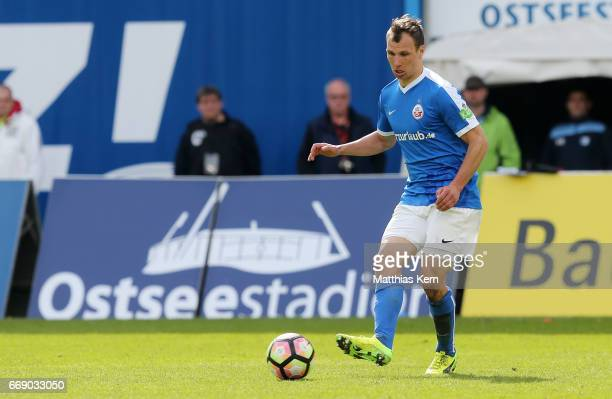 Tobias Jaenicke of Rostock runs with the ball during the third league match between FC Hansa Rostock and 1FC Magdeburg at Ostseestadion on April 15...
