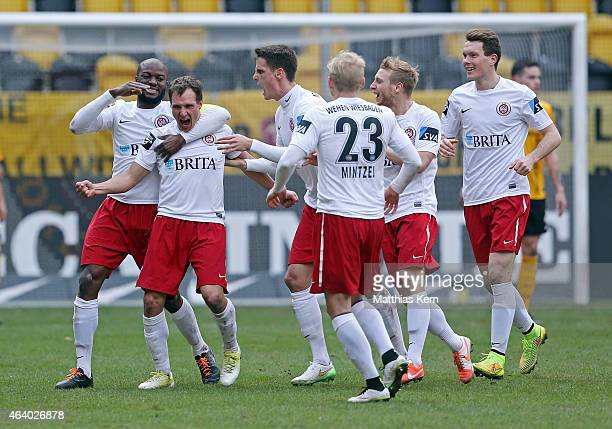 Tobias Jaenicke of Wiesbaden jubilates with team mates after scoring the first goal during the third league match between SG Dynamo Dresden and Wehen...