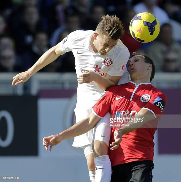 Tobias Jaenicke of Wiesbaden jumps for a header with Marc Wachs of Mainz during the Third league match between SV Wehen Wiesbaden and 1 FSV Mainz 05...