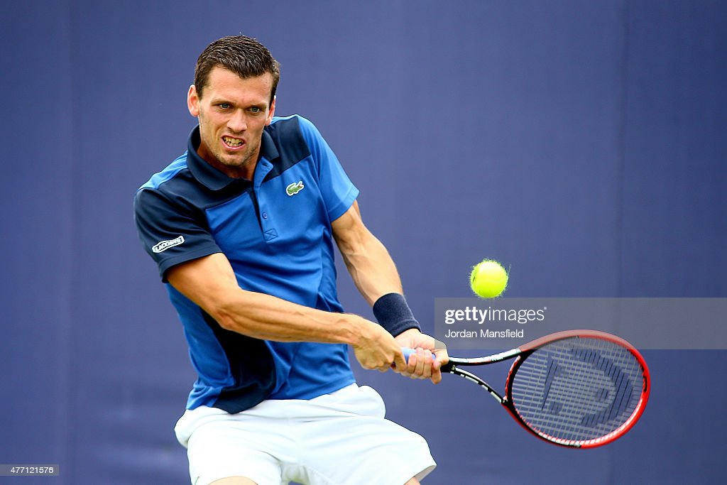 Tobias Kamke of Germany plays a backhand during his Qualification match of the Aegon Championships against Jared Donaldson of the USA at Queens Club on June 14, 2015 in London, England.