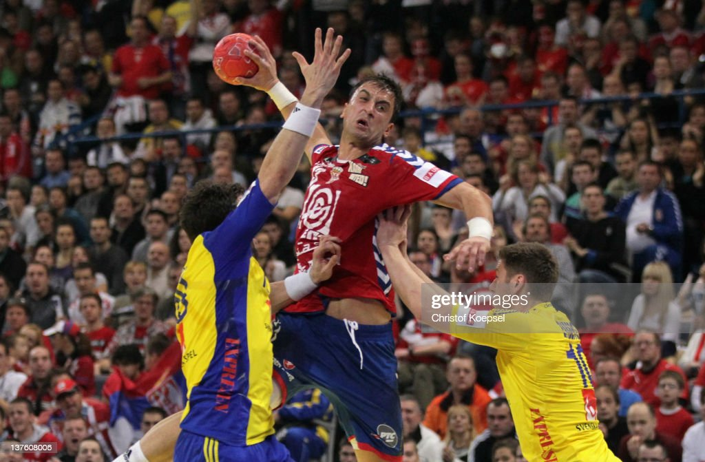 Tobias Karlsson and Niclas Ekberg of Sweden defend against Momir Ilic of Serbia during the Men's European Handball Championship second round group...