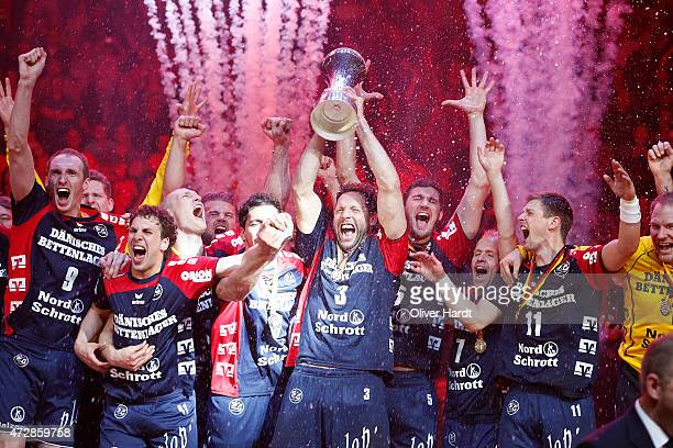 Tobias Karlsson of Flensburg celebrates with the tropy after the DHB Cup Final match between SG FlensburgHandewitt and SC Magdeburg at O2 World on...