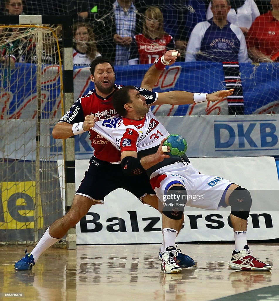 Tobias Karlsson of Flensburg (L) is challenged by Jurecki Bartosz (R) of Magdeburg during the DKB Handball Bundesliga match between SG Flensburg-Handewitt and SC Magdeburg at Campus Hall on November 13, 2012 in Flensburg, Germany.